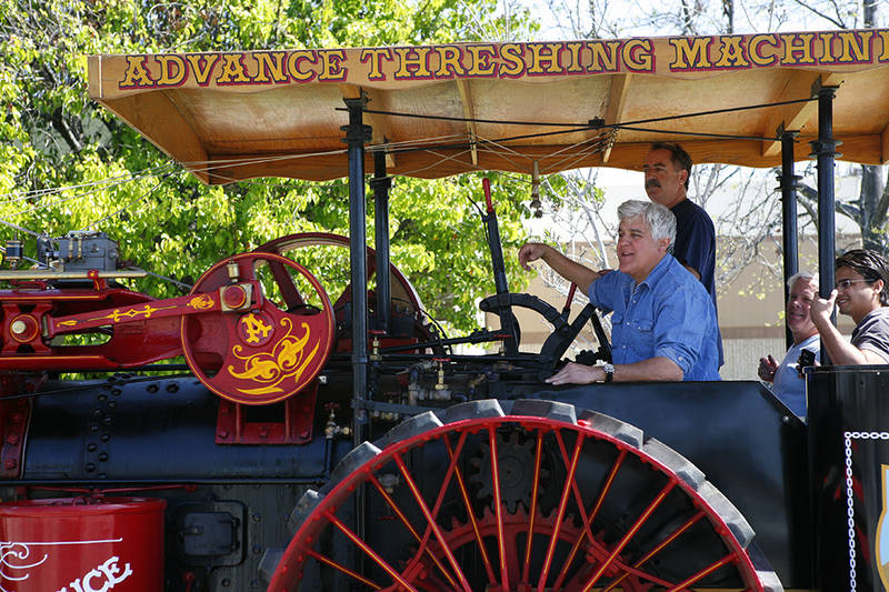 JayRiding with Jay Leno on his century-old threshing tractor. Jay particularly enjoys steam-engined vehicles because they take time to maintain and prepare for work or play. Conversely, he loves his early 20th-century electrics because they're so easy.