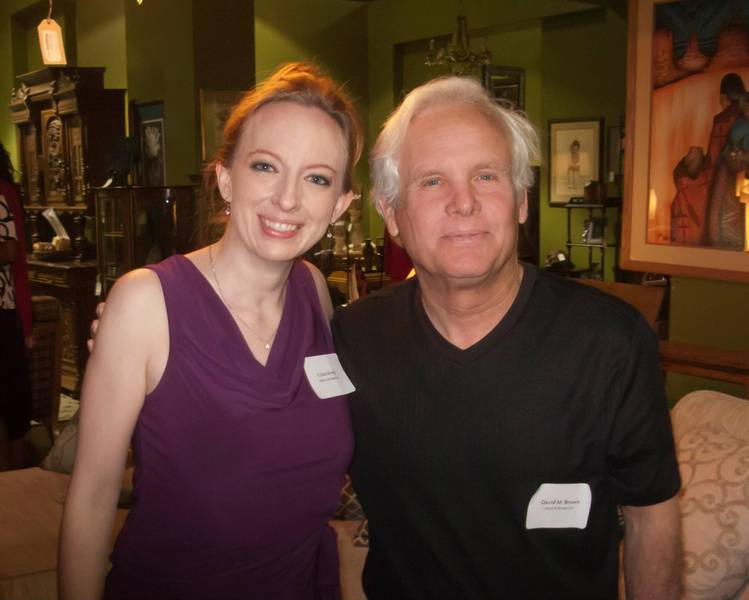 I didn't need any goading, green, purple or otherwise, to pose with Crista Alvey, an associate with Green Living Magazine, at a recent get-together.