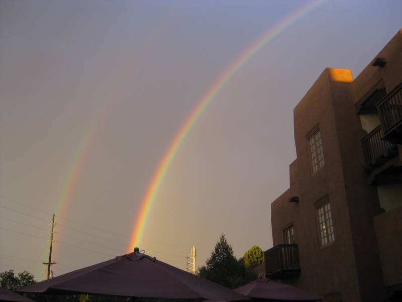 Two rainbows over Santa Fe after a summer storm. A third one was also forming: Gorgeous, but no gold, although leprechauns keep sending me cheap e-mails.